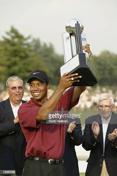 Tiger Woods poses with the trophy after winning the Buick Open on August 11 2002 at Warwick Hill Golf Country Club in Grand Blanc Michigan