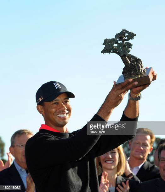 Tiger Woods poses with the trophy celebrating his win at the Farmers Insurance Open at Torrey Pines Golf Course on January 28 2013 in La Jolla...