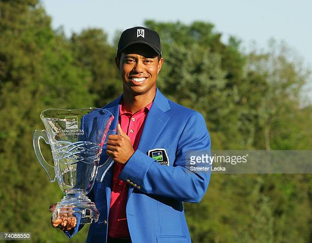 Tiger Woods poses with the winner's trophy after his twostroke victory at the Wachovia Championship at Quail Hollow Club on May 6 2007 in Charlotte...