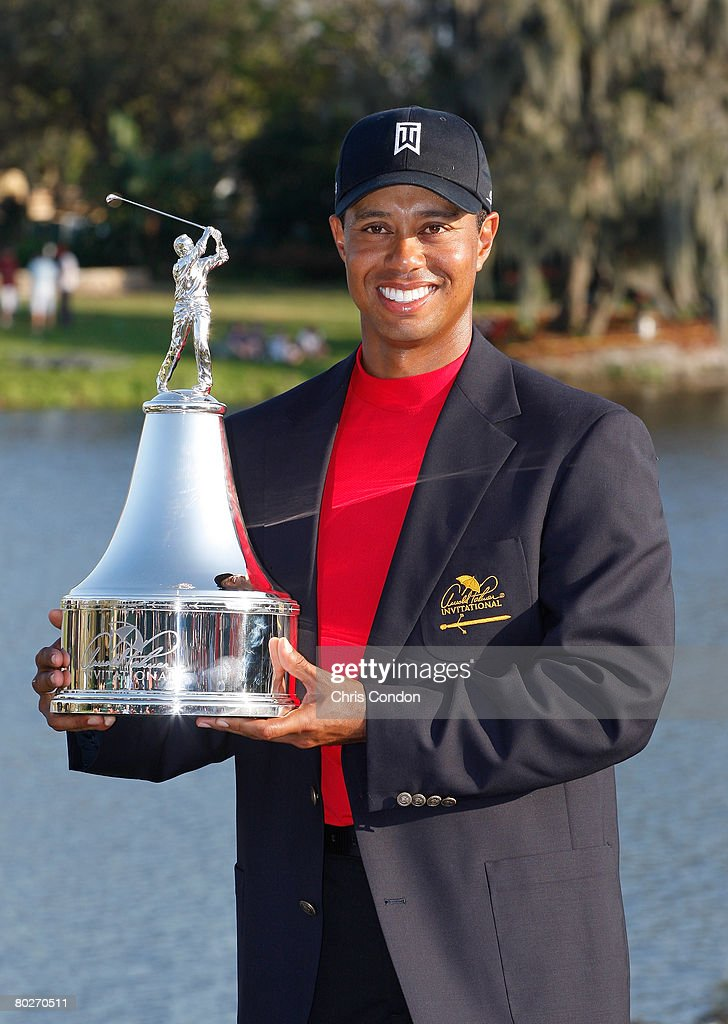 Tiger Woods poses with the winners trophy after his ...
