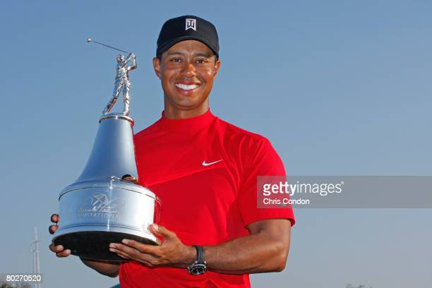 Tiger Woods poses with the winners trophy after his victory in the Arnold Palmer Invitational presented by MasterCard held on March 16 2008 at Bay...