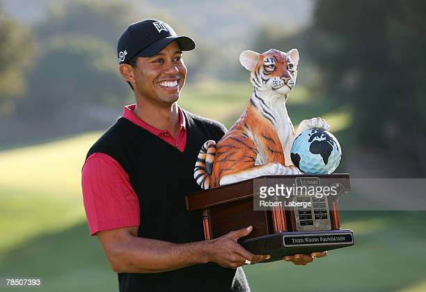 Tiger Woods poses with the winner's trophy after winning the Target World Challenge at the Sherwood Country Club on December 16, 2007 in Thousand...