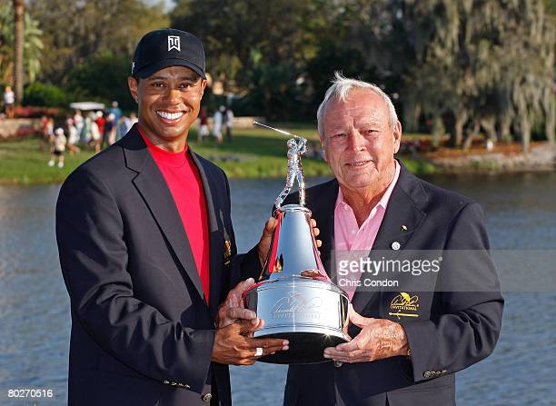 Tiger Woods poses with the winners trophy and Arnold Palmer after his victory in the Arnold Palmer Invitational presented by MasterCard held on March...