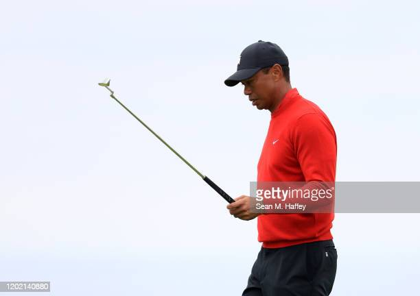 Tiger Woods prepares to putt on the 14th green during the final round of the Farmers Insurance Open at Torrey Pines South on January 26, 2020 in San...