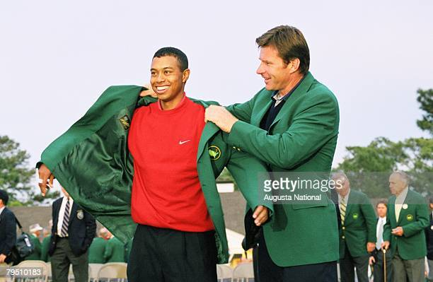 Tiger Woods Puts On The Green Jacket With The Help Of Nick Faldo During The Presentation Ceremony Of The 1997 Masters Tournament