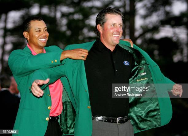 Tiger Woods puts the green jacket on Phil Mickelson after he won The Masters at the Augusta National Golf Club after the final round on April 9 2006...