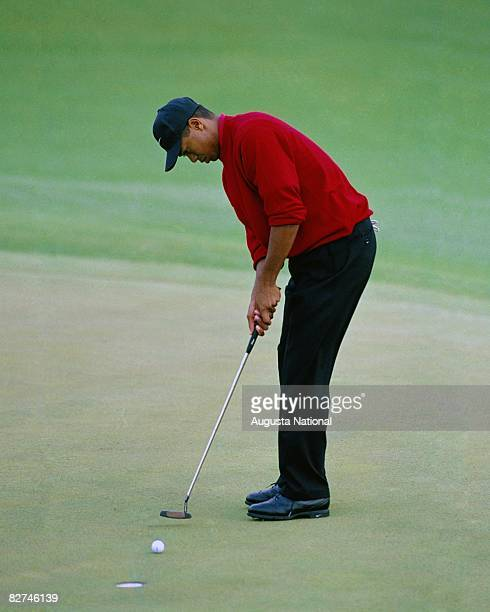 Tiger Woods putts during the 1997 Masters Tournament at Augusta National Golf Club on April 1013 1997 in Augusta Georgia