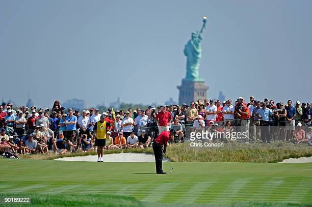 Tiger Woods putts for birdie on during the final round of The Barclays at Liberty National Golf Club on August 30, 2009 in Jersey City, New Jersey.