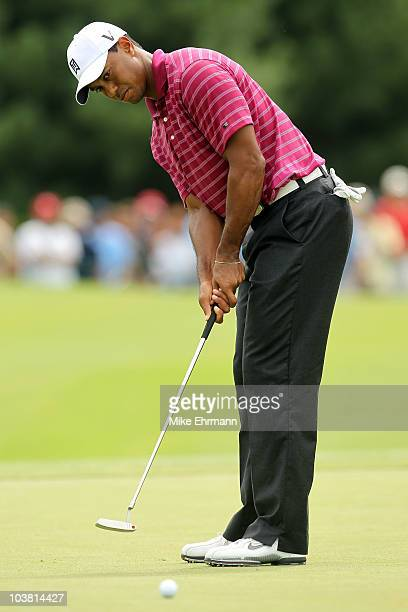 Tiger Woods putts on the 10th green during the first round of the Deutsche Bank Championship at TPC Boston on September 3, 2010 in Norton,...