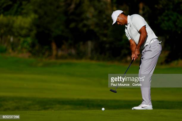 Tiger Woods putts on the 12th Hole during the second round of the Genesis Open at the Riviera Country Club Golf Course on February 16 2018 in Pacific...