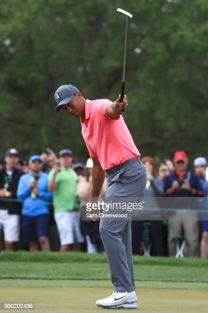 Tiger Woods reacts after a birdie putt on the tenth hole during the third round of the Valspar Championship at Innisbrook Resort Copperhead Course on...
