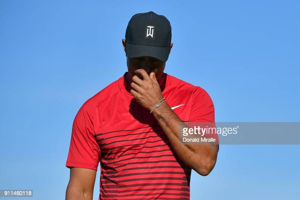 Tiger Woods reacts after a putt on the 13th green during the final round of the Farmers Insurance Open at Torrey Pines South on January 28 2018 in...