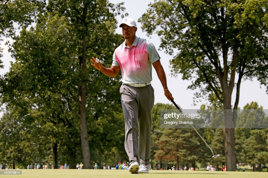 Tiger Woods reacts after a putt on the second green during the first round of the World Golf Championships-Bridgestone Invitational at Firestone Country Club South Course on July 31, 2014 in Akron, Ohio.