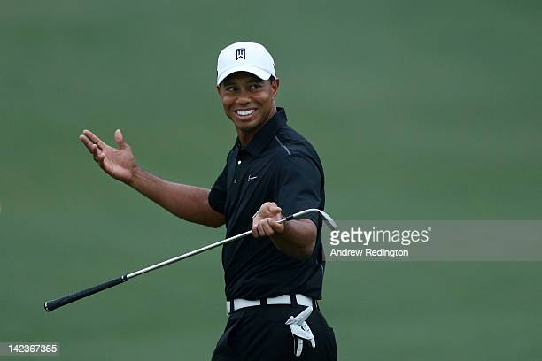 Tiger Woods reacts after a shot during a practice round prior to the start of the 2012 Masters Tournament at Augusta National Golf Club on April 3...