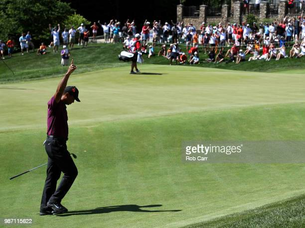 Tiger Woods reacts after chipping in for birdie on the 18th hole during the second round of the Quicken Loans National at TPC Potomac on June 29 2018...
