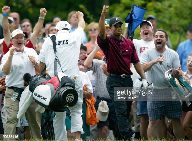 Tiger Woods reacts after chipping in for par on the 14th hole during the final round of the Memorial Tournament on June 6, 2004 at Muirfield Village...
