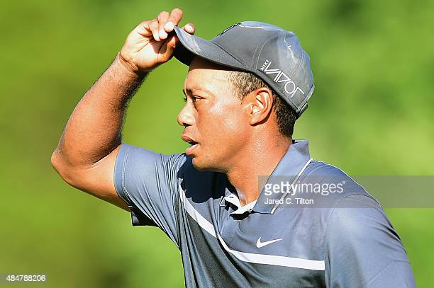 Tiger Woods reacts after he completes his round on the 18th green during the second round of the Wyndham Championship at Sedgefield Country Club on...