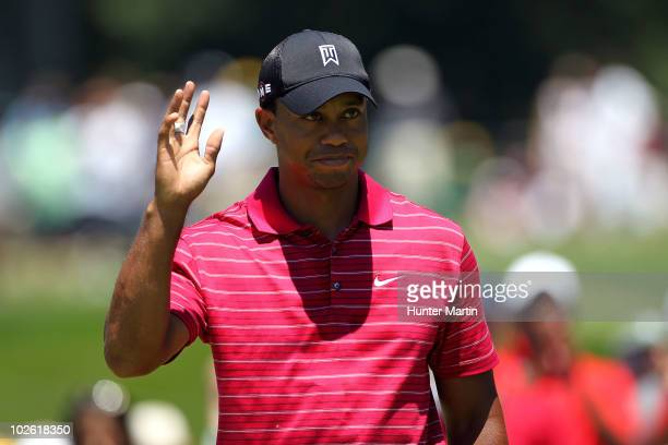 Tiger Woods reacts after he made a birdie putt on the 11th green during the final round of the ATT National at Aronimink Golf Club on July 4 2010 in...