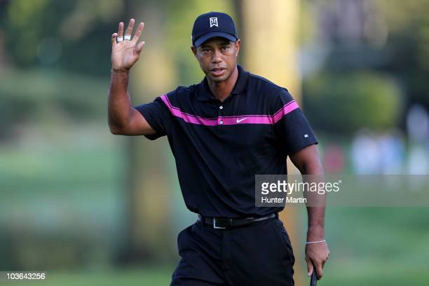 Tiger Woods reacts after he made a birdie putt on the first hole during the first round of The Barclays at the Ridgewood Country Club on August 26...