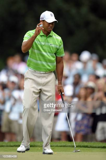 Tiger Woods reacts after he made a birdie putt on the third hole during the second round of the AT&T National at Aronimink Golf Club on July 2, 2010...