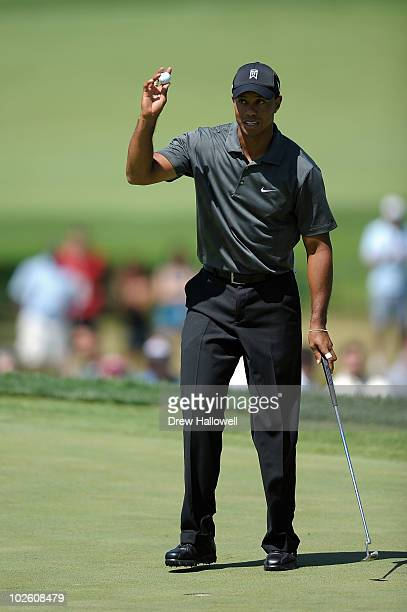 Tiger Woods reacts after he made a birdie putt the 11th green during the third round of the ATT National at Aronimink Golf Club on July 3 2010 in...