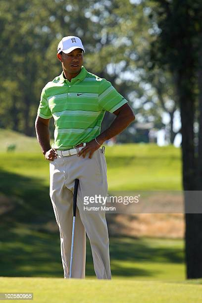 Tiger Woods reacts after he missed a birdie putt attempt on the 10th hole during the second round of the AT&T National at Aronimink Golf Club on July...