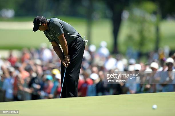 Tiger Woods reacts after he missed a birdie putt attempt on the 12th during the third round of the ATT National at Aronimink Golf Club on July 3 2010...