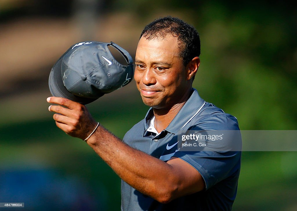Tiger Woods reacts after his par putt on the 18th green during the second round of the Wyndham Championship at Sedgefield Country Club on August 21, 2015 in Greensboro, North Carolina.