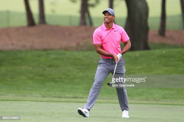 Tiger Woods reacts after hitting his second shot on the 5th hole during the third round of the Valspar Championship on March 10 at Westin...