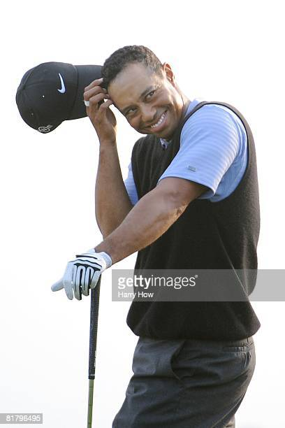 Tiger Woods reacts after holing out from the rough for birdie on the 17th hole during the third round of the 108th US Open at the Torrey Pines Golf...