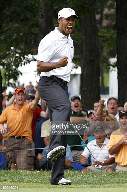 Tiger Woods reacts after making a birdie putt on the 17th green during the third round of the Buick Open at Warwick Hills Golf and Country Club on...