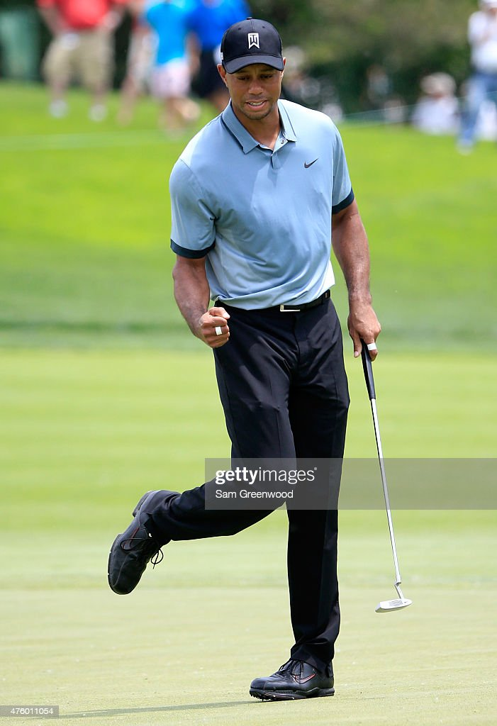 Tiger Woods reacts after making a birdie putt on the fourth hole during the second round of The Memorial Tournament presented by Nationwide at Muirfield Village Golf Club on June 5, 2015 in Dublin, Ohio.