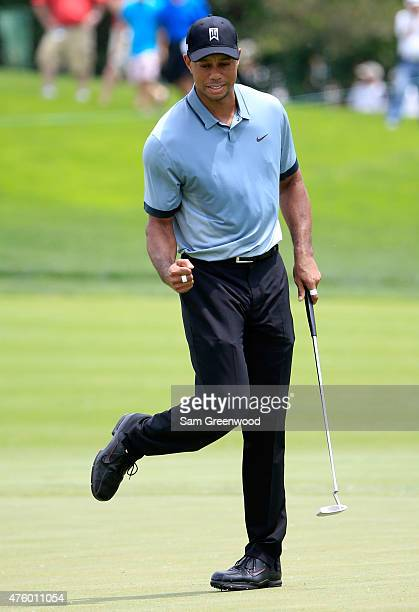 Tiger Woods reacts after making a birdie putt on the fourth hole during the second round of The Memorial Tournament presented by Nationwide at...