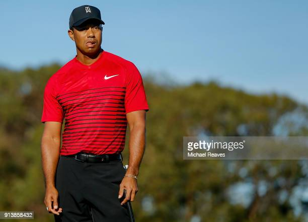 Tiger Woods reacts after missing a putt on the 13th green during the final round of the Farmers Insurance Open at Torrey Pines South on January 28...