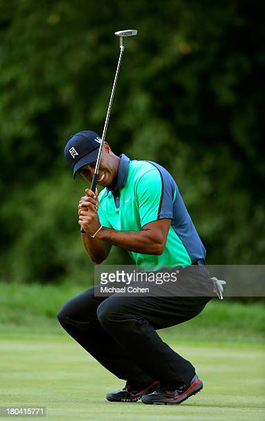 Tiger Woods reacts after missing a putt on the sixth green during the First Round of the BMW Championship at Conway Farms Golf Club on September 12,...