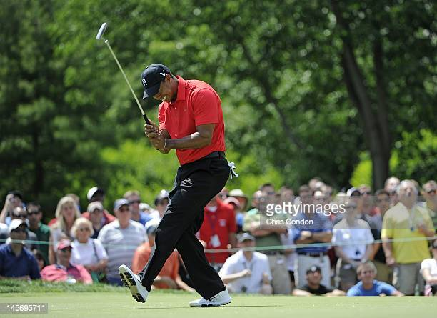 Tiger Woods reacts after missing an eagle putt on the 7th green during the final round of the Memorial Tournament presented by Nationwide Insurance...