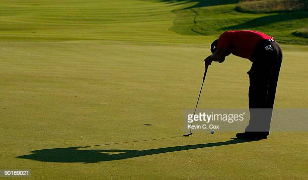 Tiger Woods reacts after missing his birdie putt on the 18th green during the final round of The Barclays on August 30 2009 at Liberty National in...