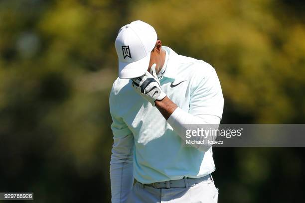 Tiger Woods reacts after playing his second shot on the seventh hole during the second round of the Valspar Championship at Innisbrook Resort...