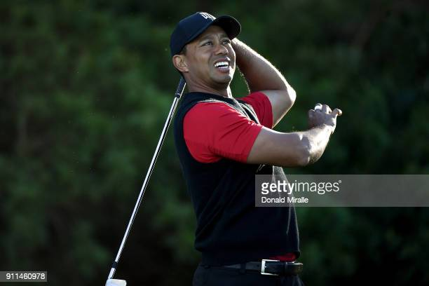 Tiger Woods reacts after playing his shot from the 11th tee during the final round of the Farmers Insurance Open at Torrey Pines South on January 28...
