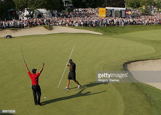 Tiger Woods reacts after winning the 2009 Buick Open at Warwick Hills Golf and Country Club with a winning score of 20 under par on August 2 2009 in...