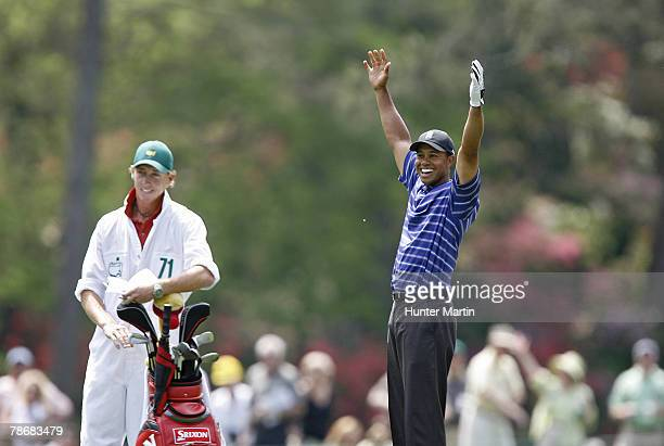 Tiger Woods reacts as he holes out his shot on 14 for a eagle during the first round of the 2006 Masters at the Augusta National Golf Club in Augusta...