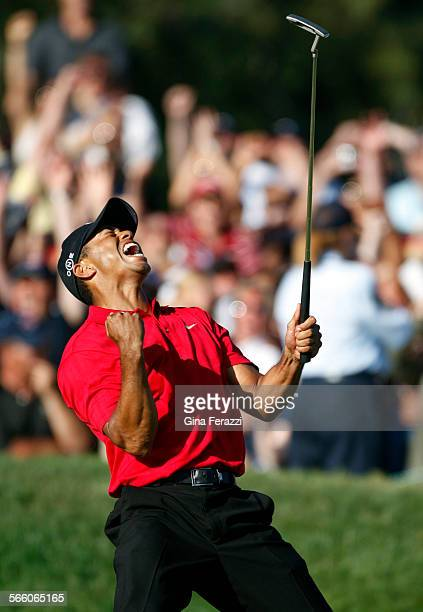 Tiger Woods reacts as he makes a birdie putt on the 18th green to force a playoff with Rocco Mediate during the final round of the US Open at Torrey...