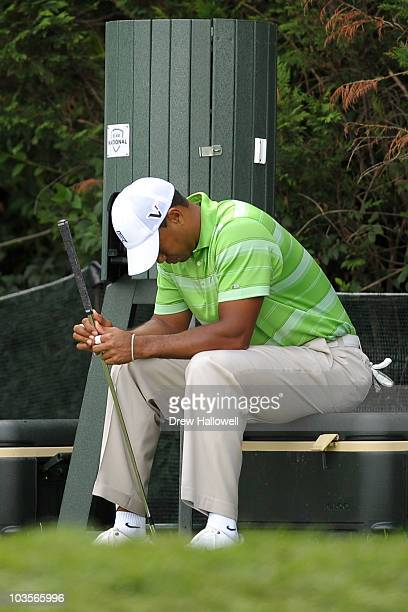 Tiger Woods reacts as he waits to hit his tee shot during the second round of the AT&T National at Aronimink Golf Club on July 2, 2010 in Newtown...