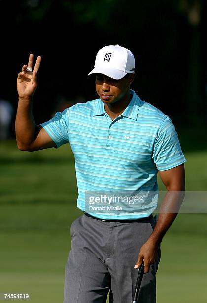 Tiger Woods reacts birdie putt on the second hole during the first round of the 107th US Open Championship at Oakmont Country Club on June 14 2007 in...