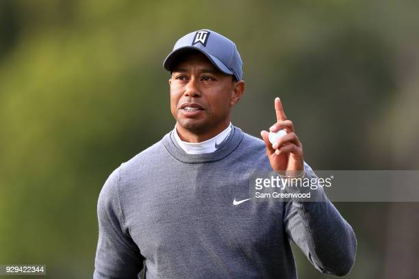 Tiger Woods reacts on the 16th green during the first round of the Valspar Championship at Innisbrook Resort Copperhead Course on March 8, 2018 in...