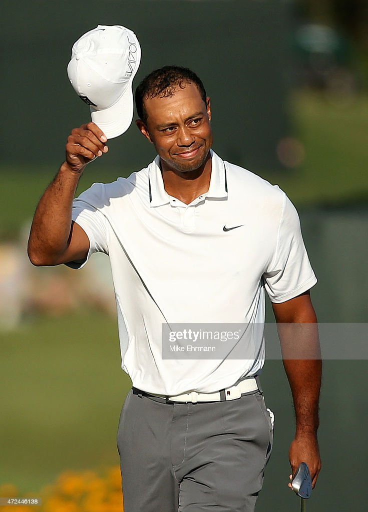 Tiger Woods reacts on the 17th green during round one of THE PLAYERS Championship at the TPC Sawgrass Stadium course on May 7, 2015 in Ponte Vedra Beach, Florida.