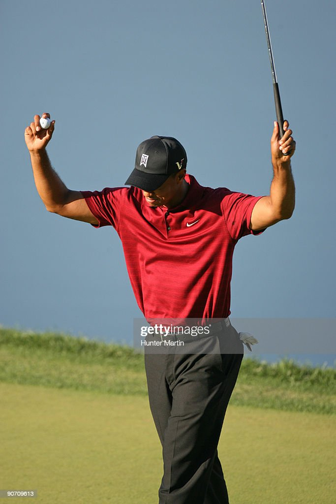 Tiger Woods reacts on the 18th green after winning the BMW Championship at Cog Hill Golf & Country Club on September 13, 2009 in Lemont, Illinois.
