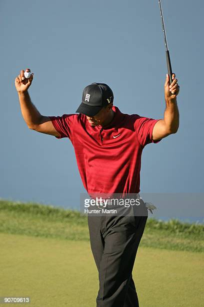 Tiger Woods reacts on the 18th green after winning the BMW Championship at Cog Hill Golf Country Club on September 13 2009 in Lemont Illinois