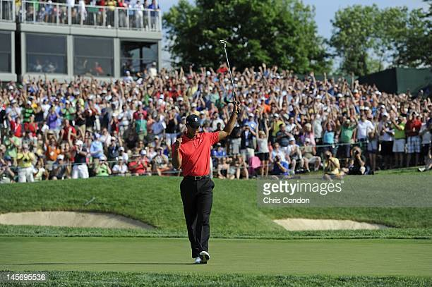 Tiger Woods reacts on the 18th green after winning the Memorial Tournament presented by Nationwide Insurance at Muirfield Village Golf Club on June 3...
