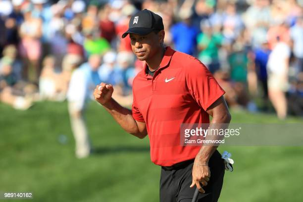 Tiger Woods reacts on the 18th green during the final round of the Quicken Loans National at TPC Potomac on July 1, 2018 in Potomac, Maryland.